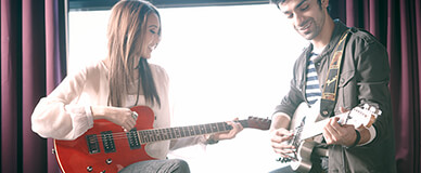 couple playing guitars